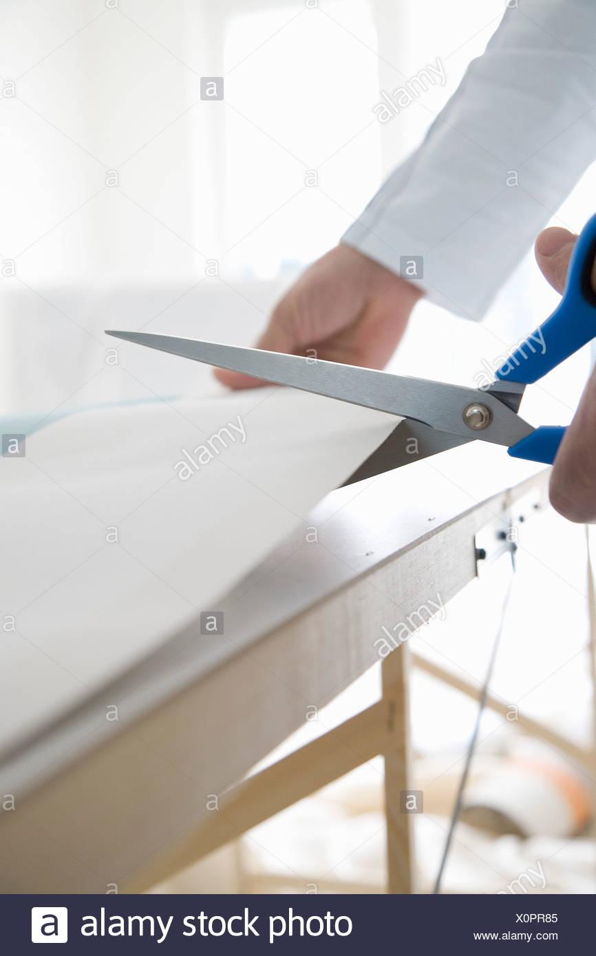 Cutting wallpaper - Stock Image