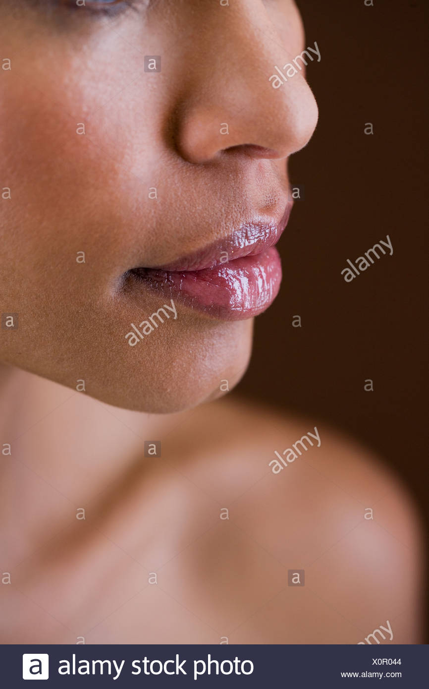 Portrait of a young woman showing the side of her face - Stock Image