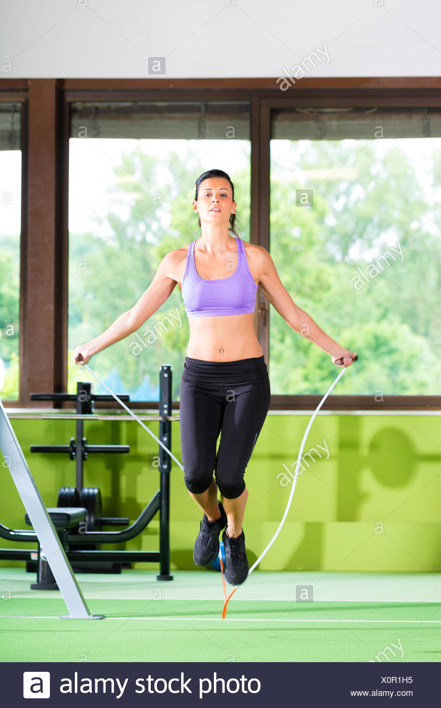 spring bouncing bounces hop skipping frisks jumping jump fitness rope woman motion postponement moving movement beautiful - Stock Image