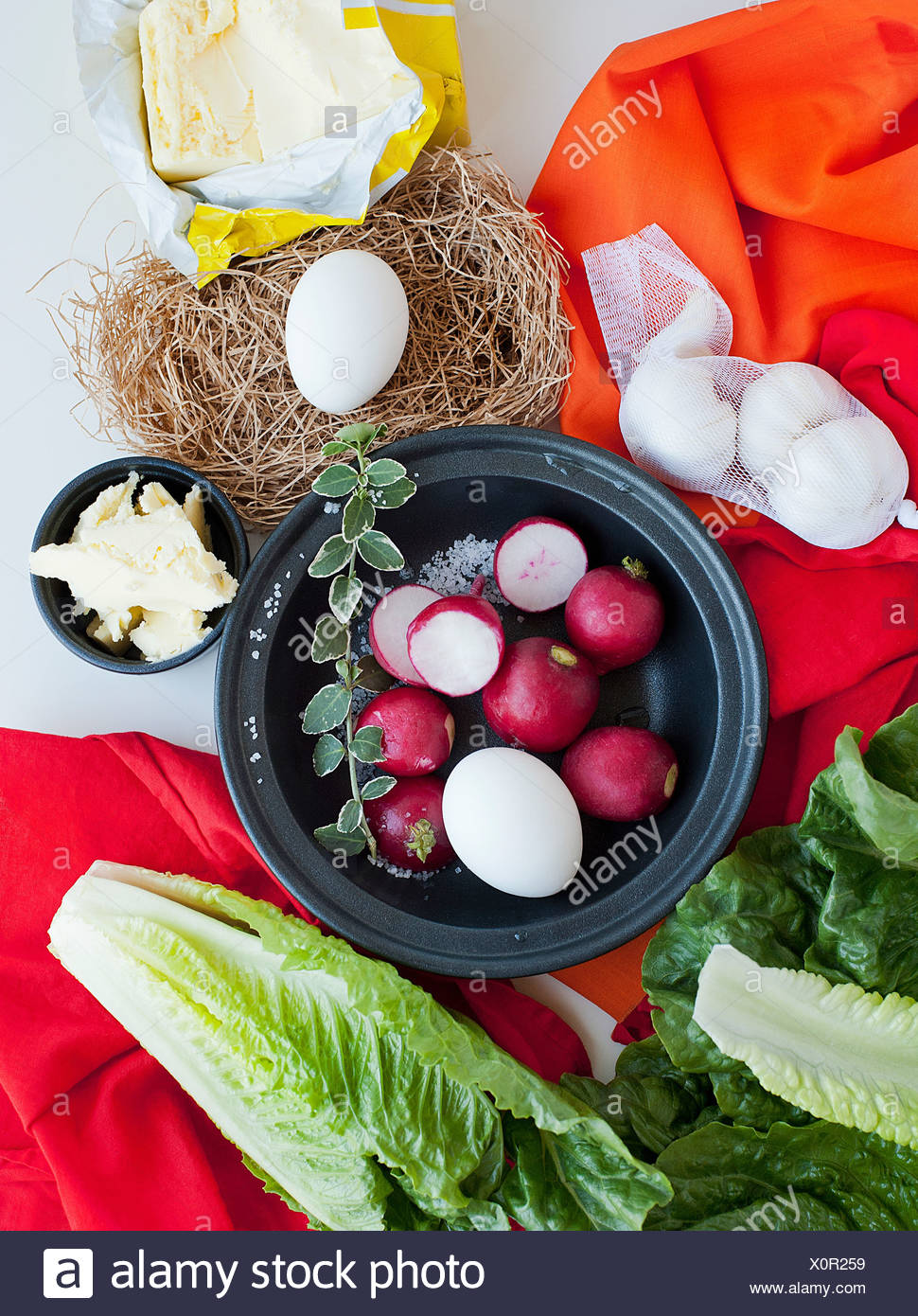 Food still life with radish, eggs and salad leaves - Stock Image