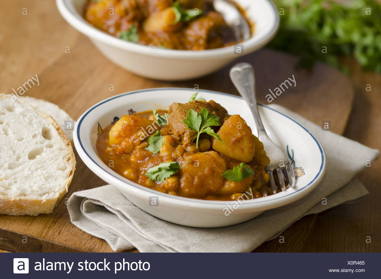 Delicious lamb curry with chickpeas in a bowl. - Stock Image