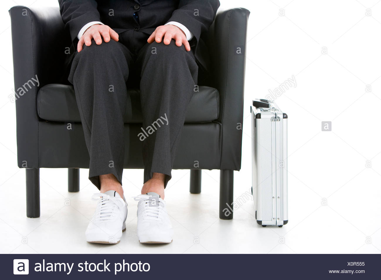 Businessman Holding Wearing Sneakers - Stock Image