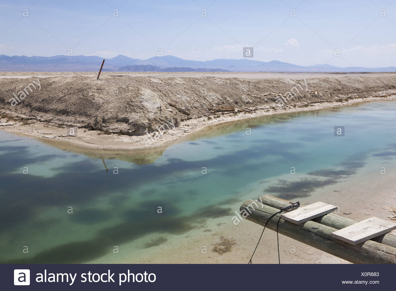 Bonneville Salt Flats Utah USA Industrial canal and water in the desert walkway - Stock Image