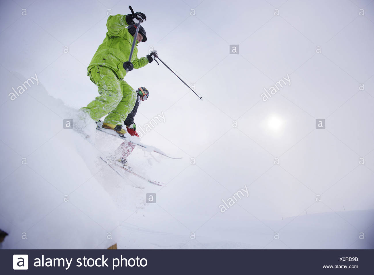 Male free skiers in deep snow, Mayrhofen, Ziller river valley, Tyrol, Austria - Stock Image