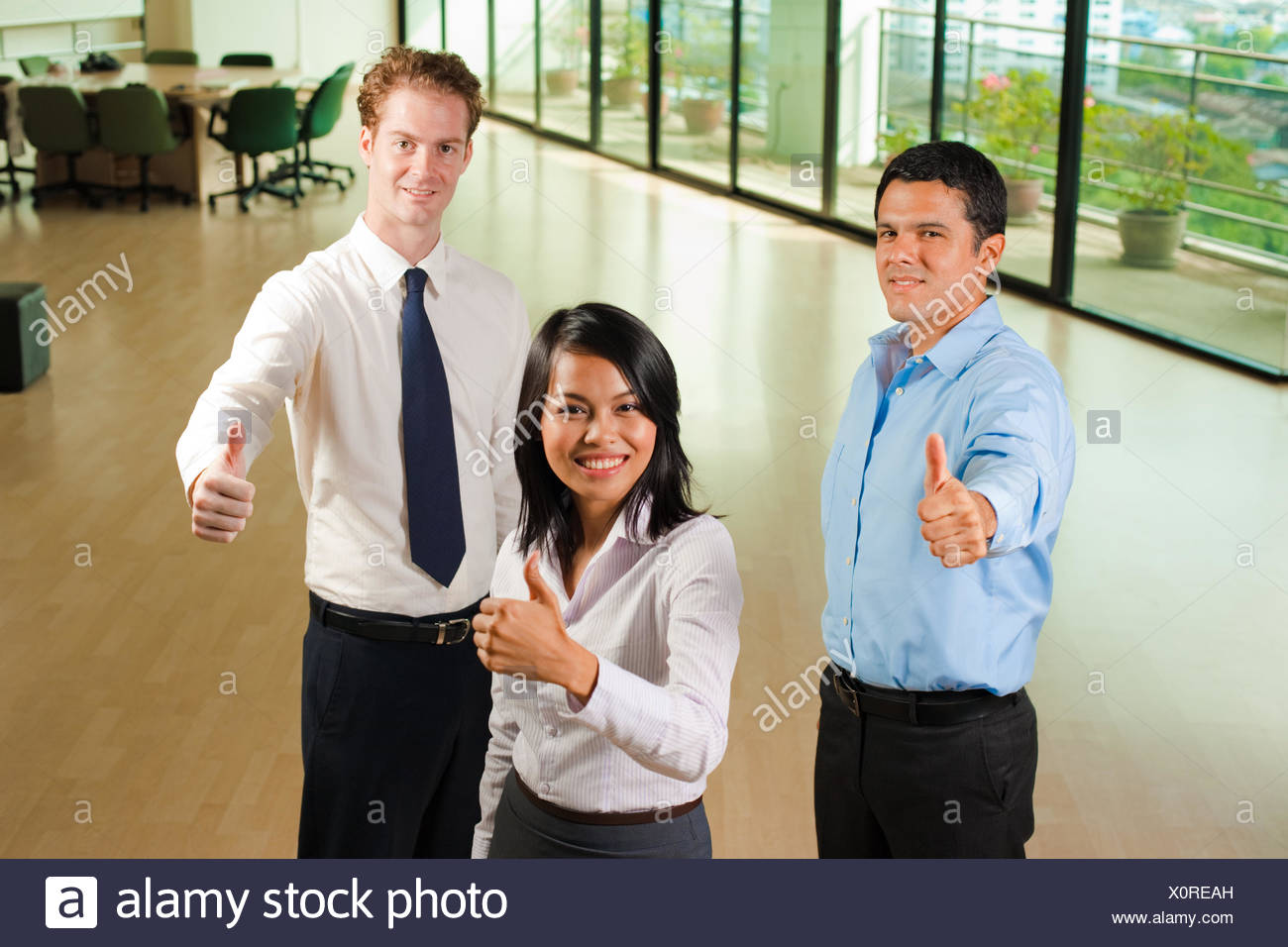 Diverse Business Team Three Thumbs Up - Stock Image