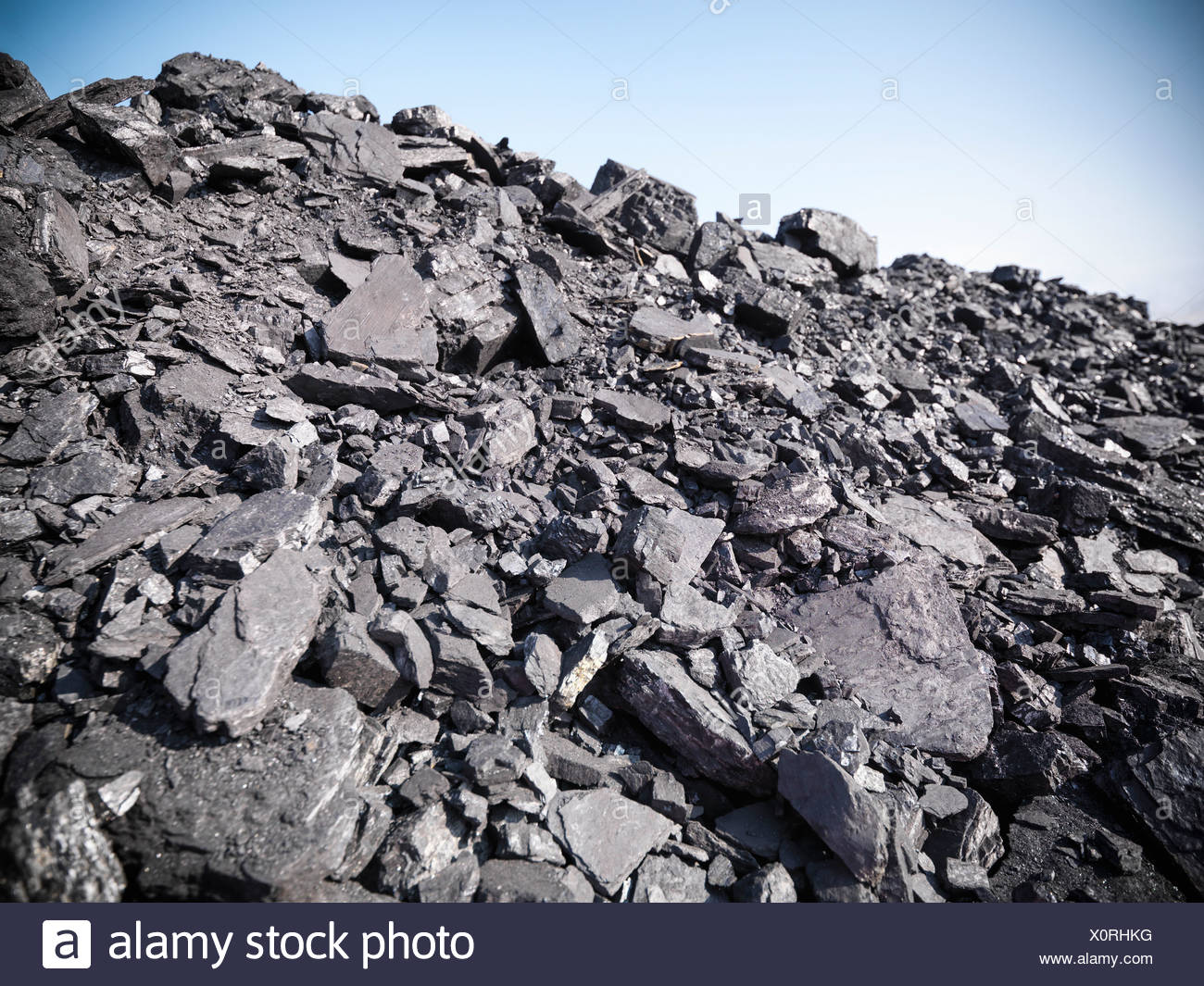 Piles of coal at mine - Stock Image