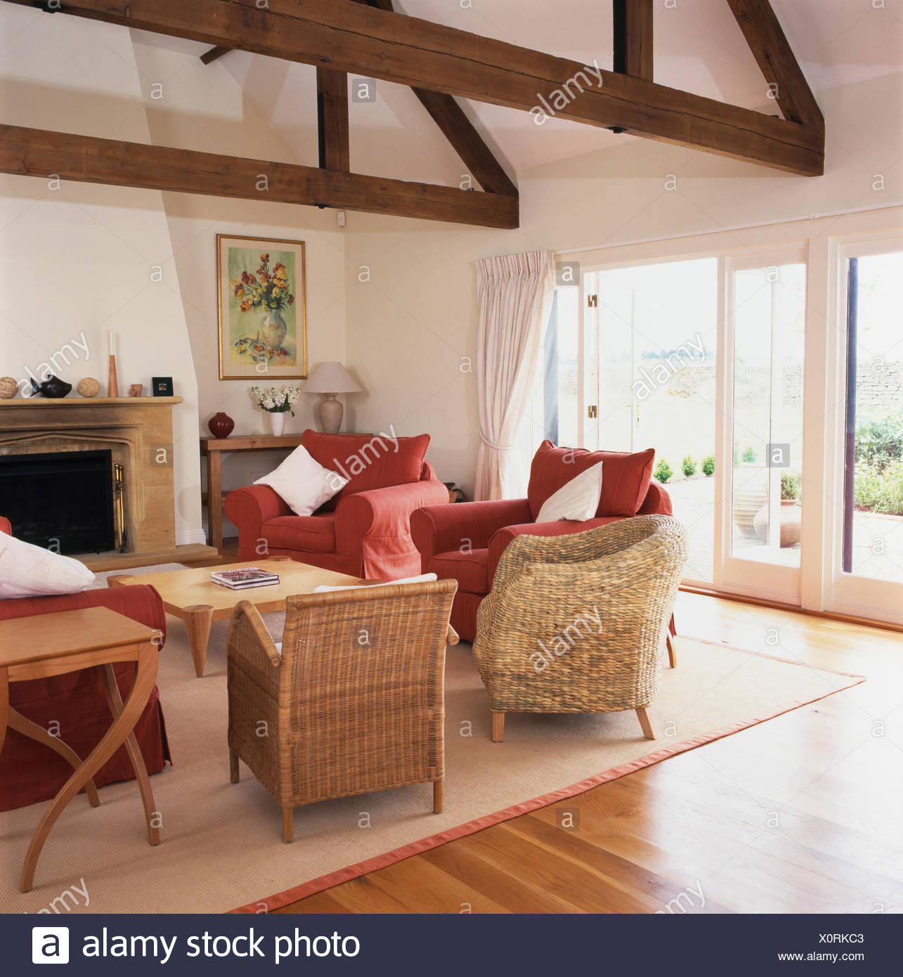 Cane And Wicker Chairs In Barn Conversion Living Room With