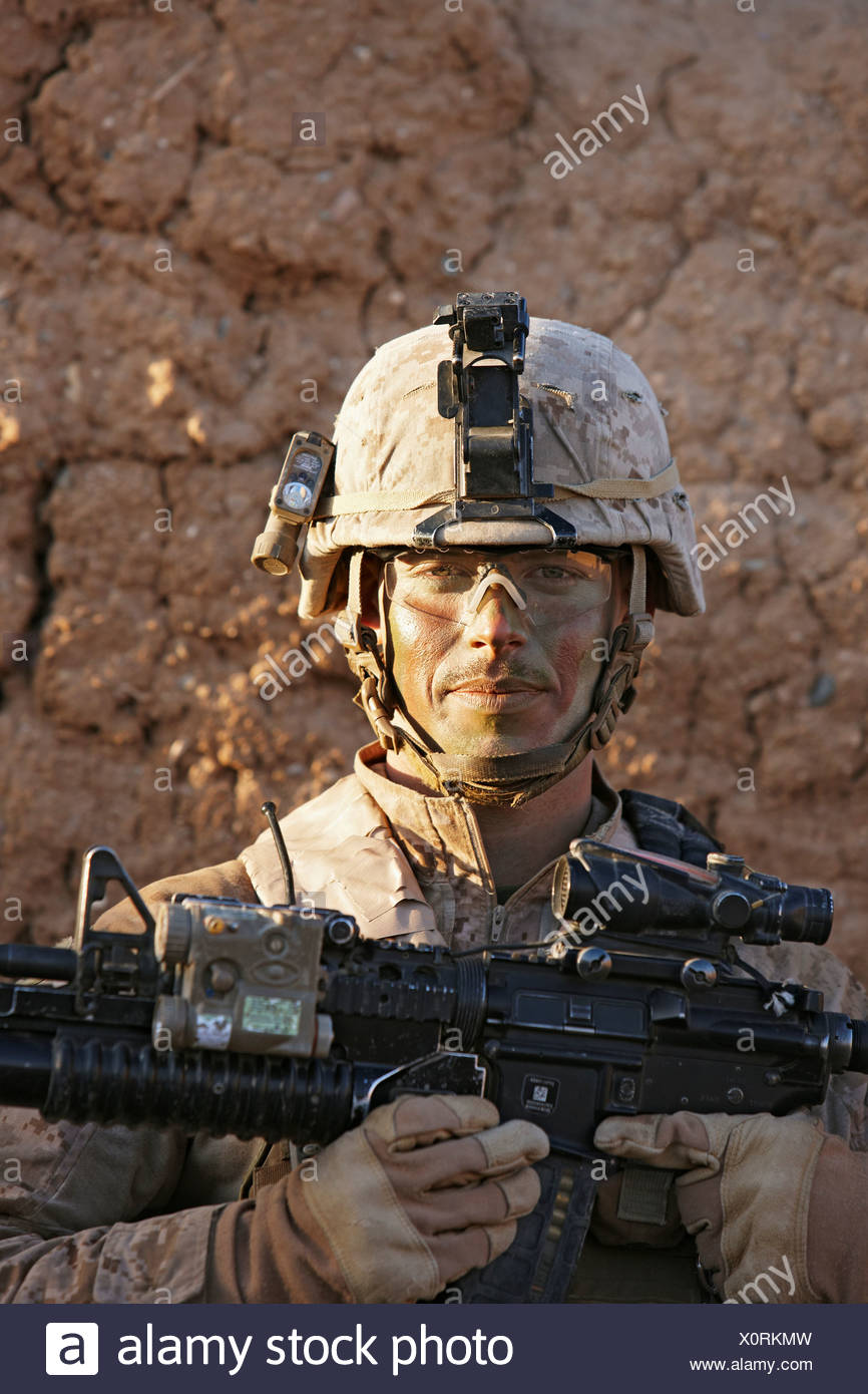 U.S. Marine Holding M4 Carbine During Combat Operation in Afghanistan's Helmand Province - Stock Image