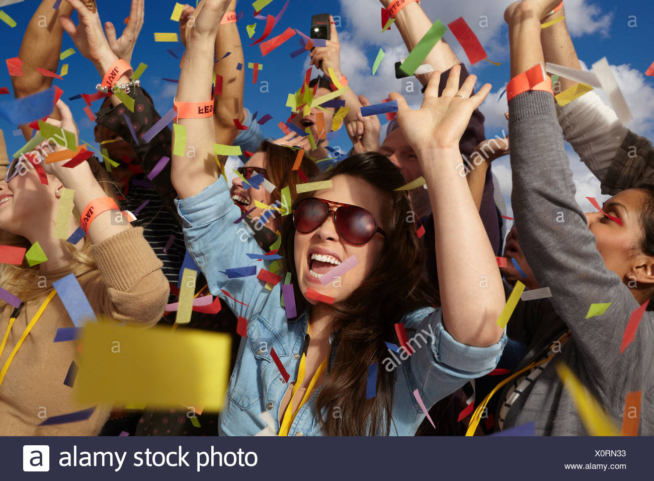 People cheering at a music festival - Stock Image