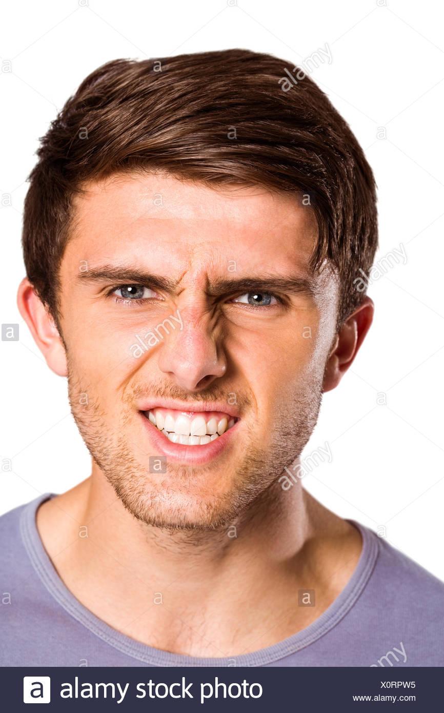 Angry young man growling at camera - Stock Image