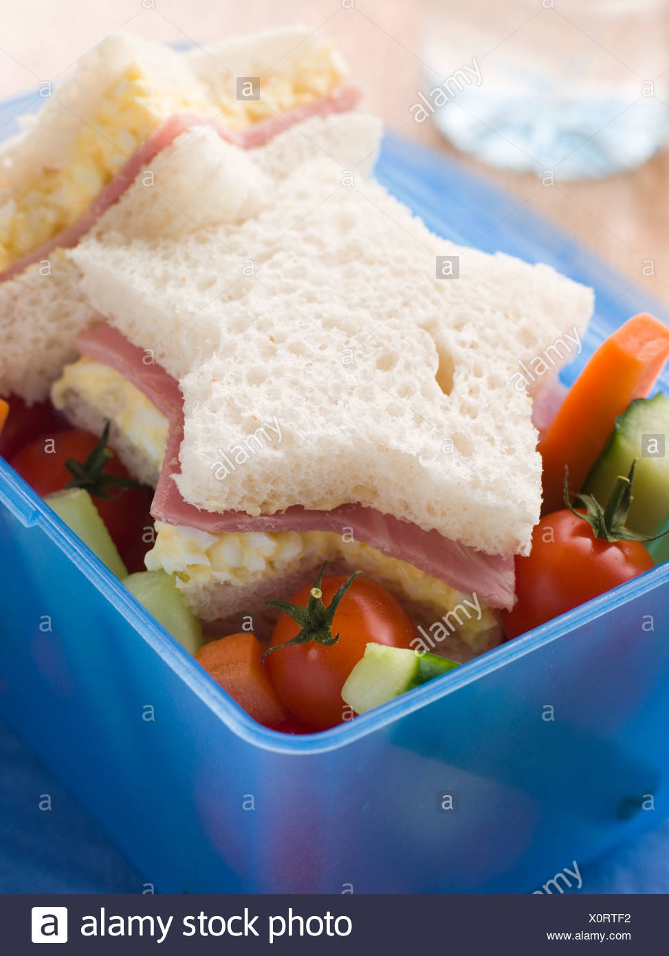 Star Shaped Egg Mayonnaise and Ham Sandwich with Crudities - Stock Image