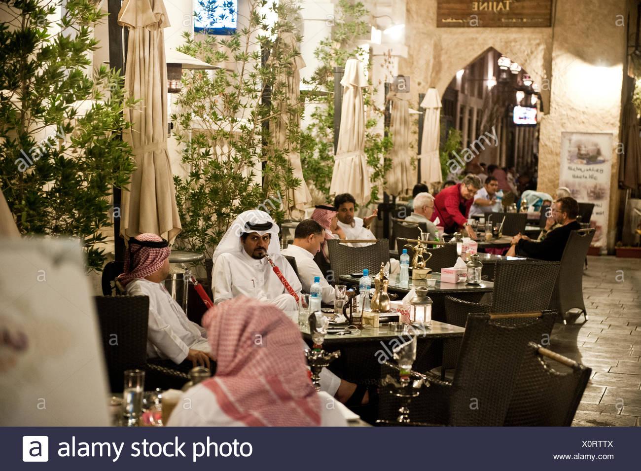 People dining and smoking shisha pipes at Al Tawash