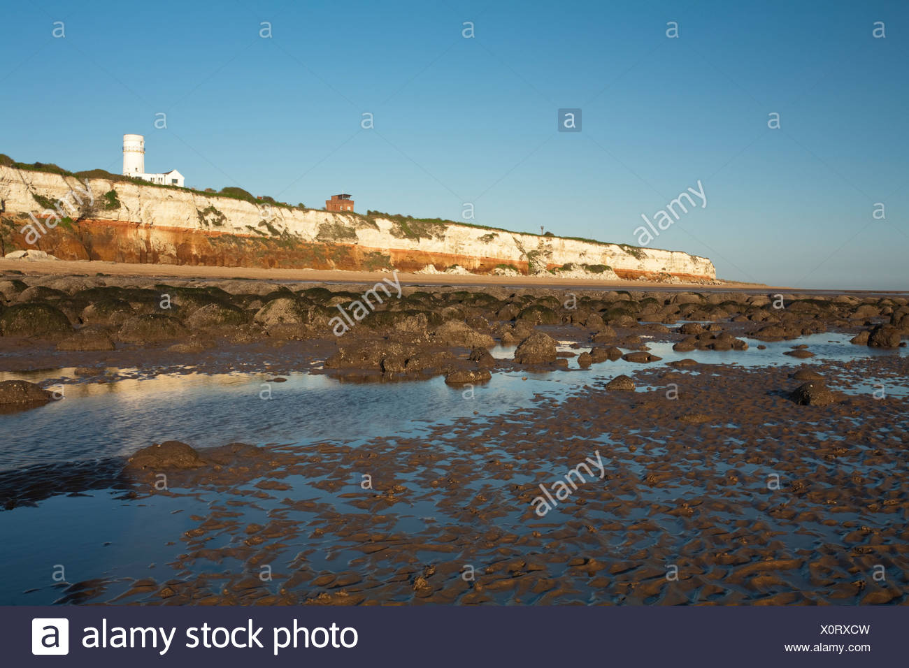 Two tone cliffs and lighthouse at Hunstanton, Norfolk, Uk - Stock Image