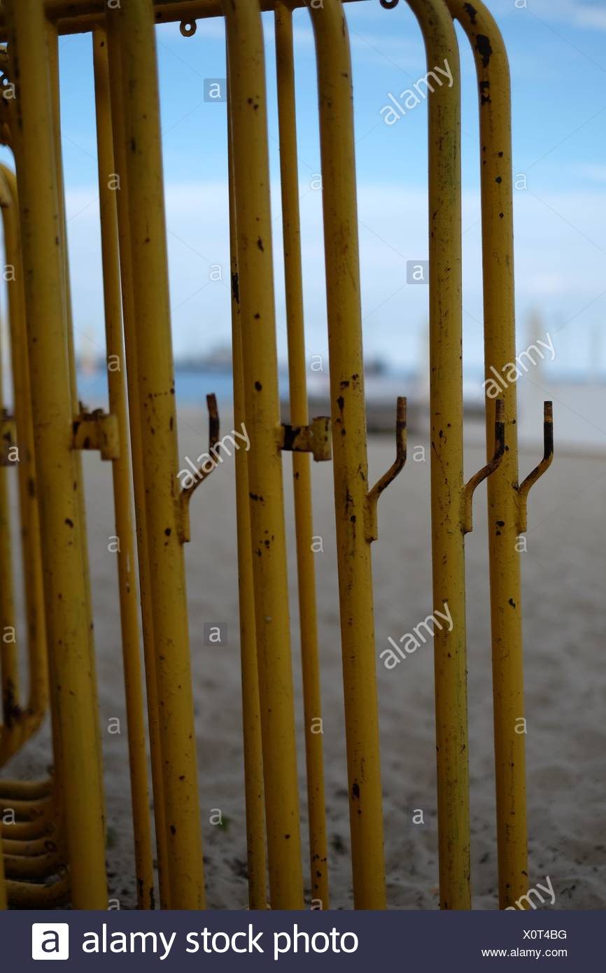 Close-Up Of Metal Bars At Beach Against Sky - Stock Image