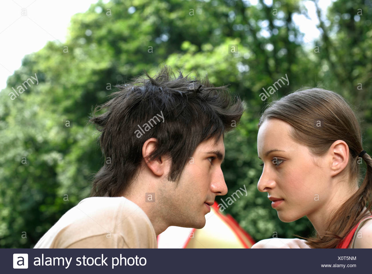 Young couple is looking in each other's eyes - Stock Image