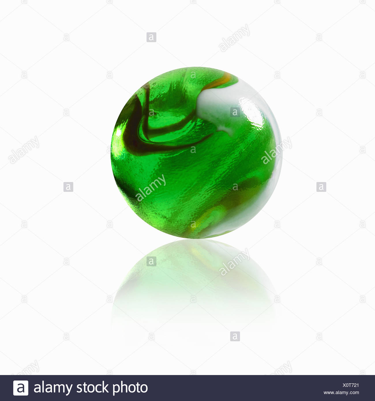 green glass marble with an interior pattern - Stock Image