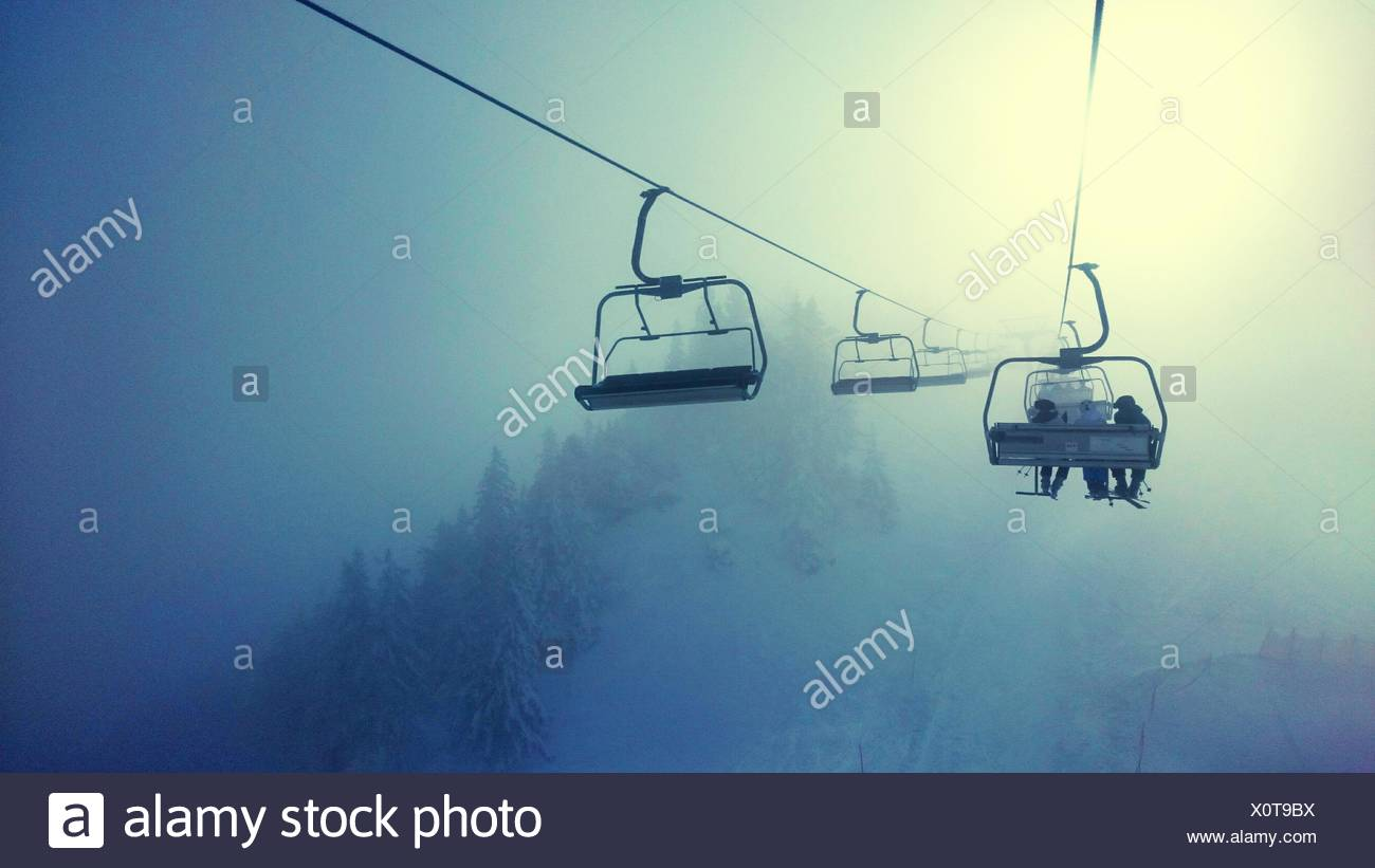 People Using Ski Lift - Stock Image