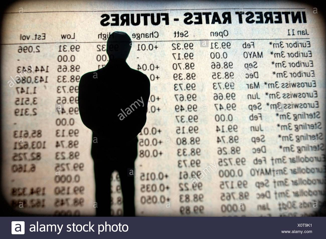 human silhouette watching the interest rates grafic. Stock Photo