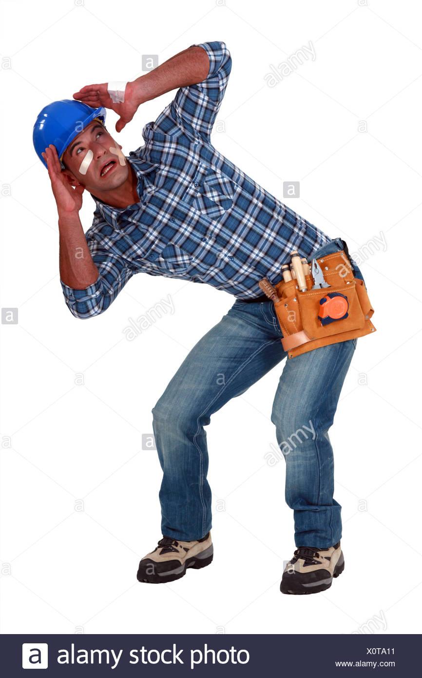 A traumatized tradesman - Stock Image