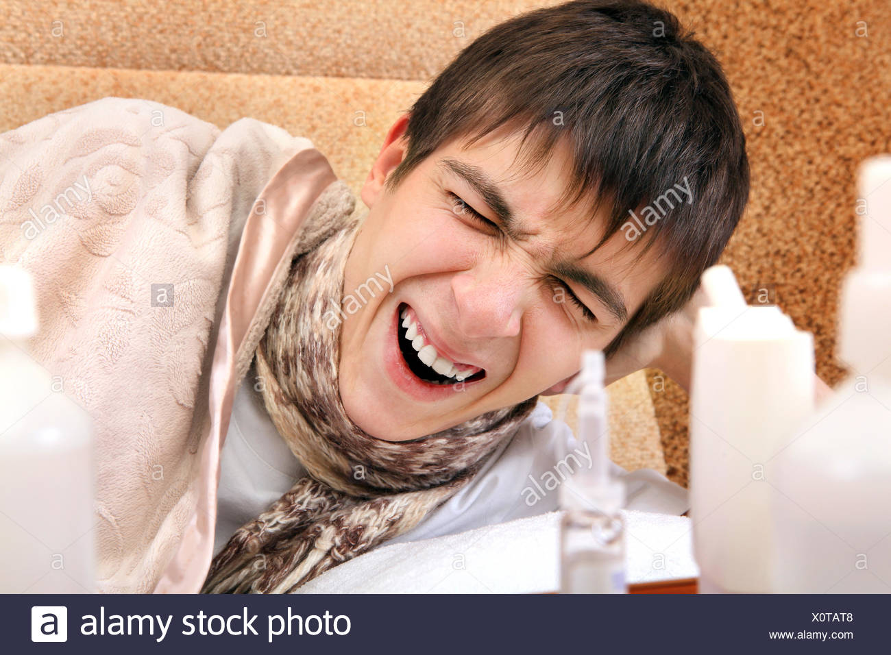 Sick Teenager yawning - Stock Image