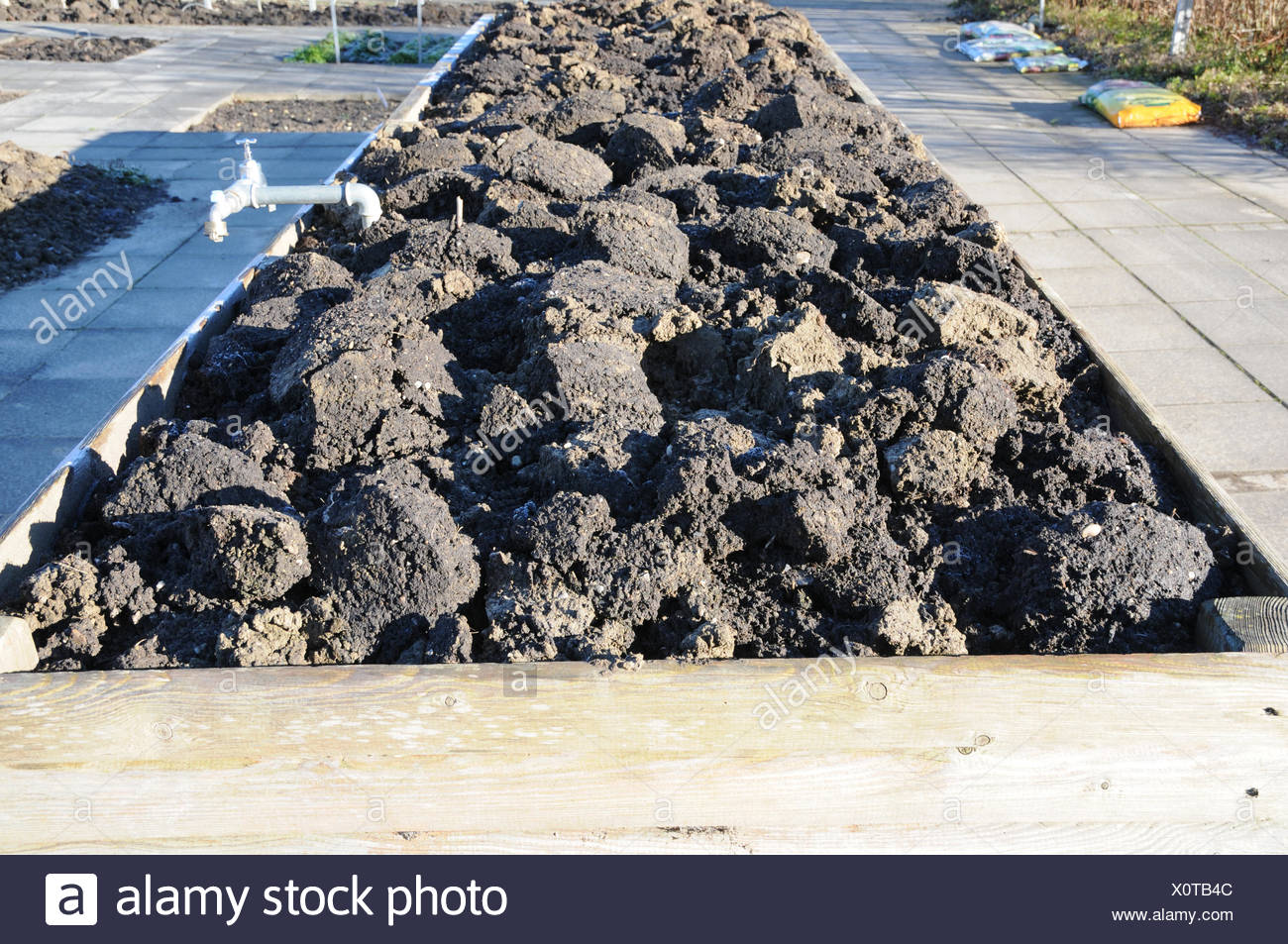 Breaked up soil in raised bed - Stock Image