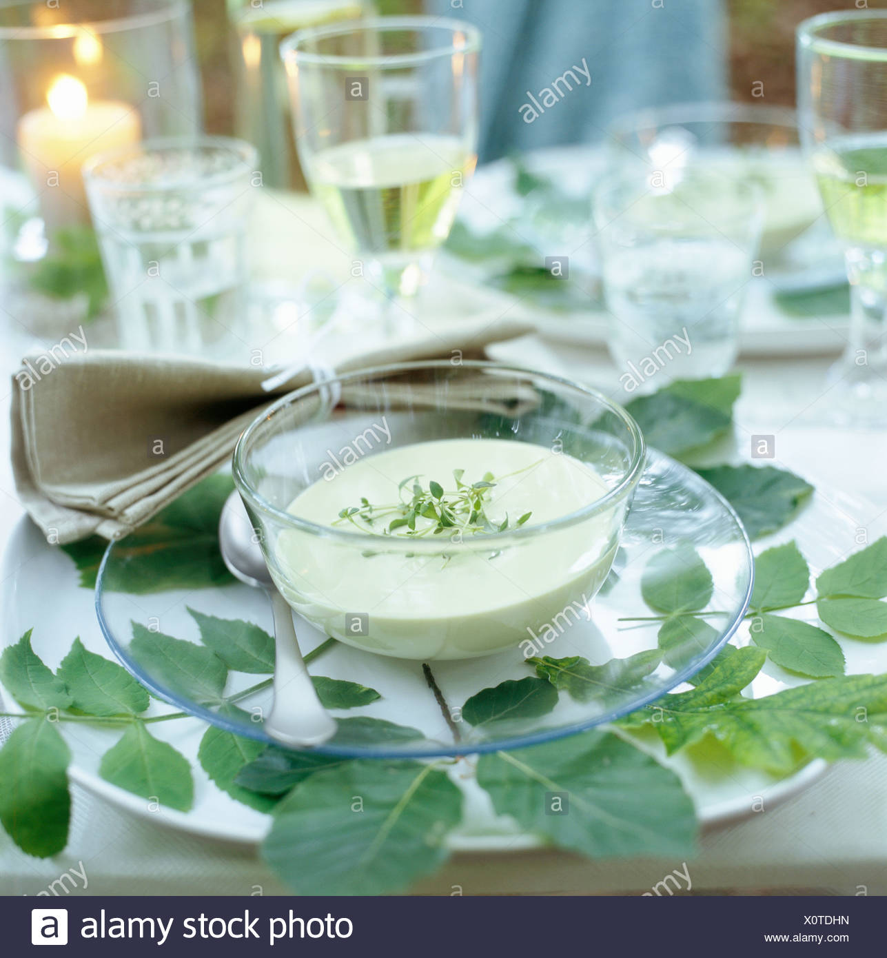 A laid table, Velamsund, Sweden. - Stock Image