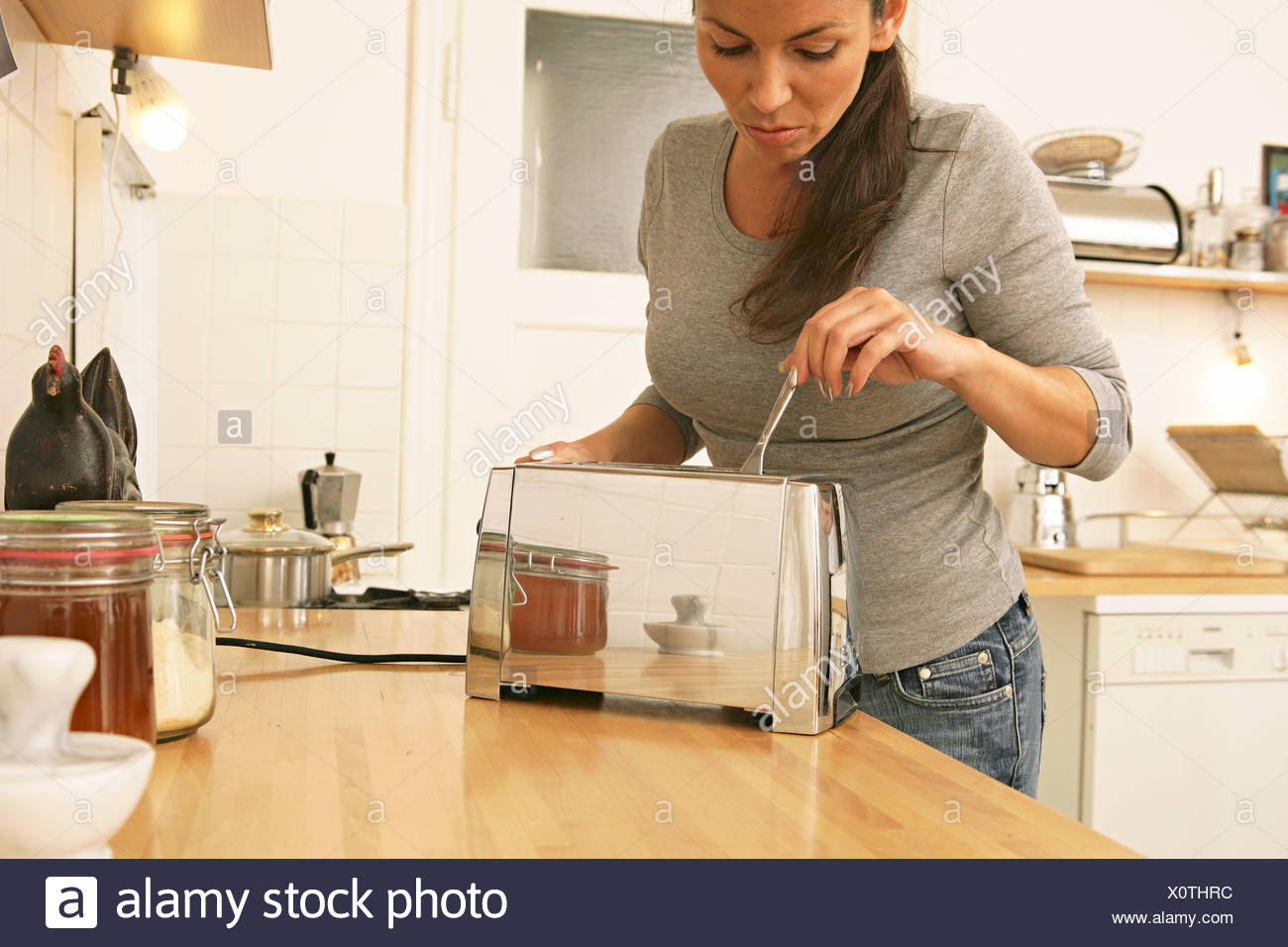 Person licking a toaster sorry
