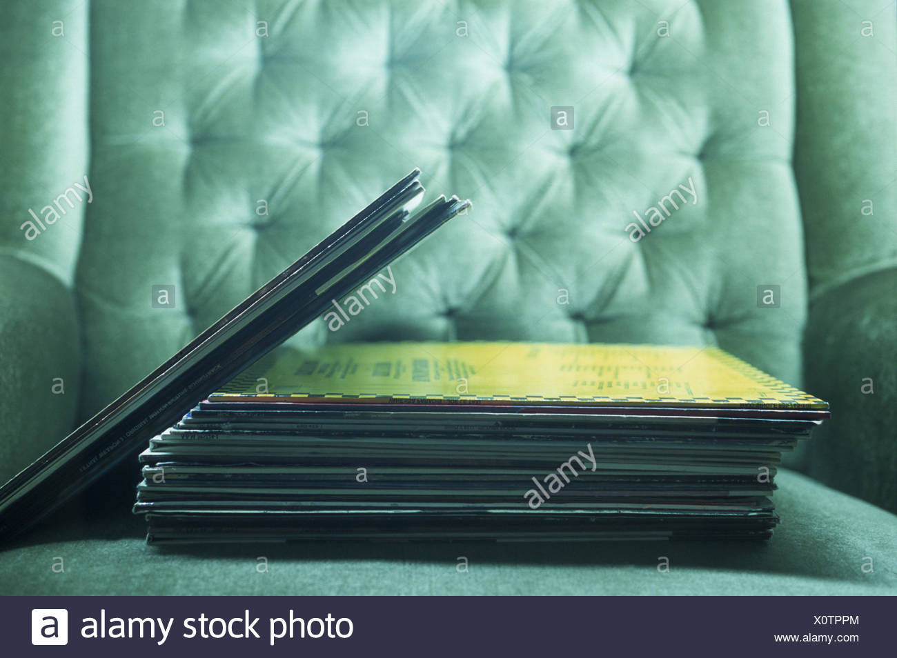 Armchair, long-playing records, upholstered chairs, LP, LP's, records, vinyl, cover, disk cover, disk covers, dust covers, product photography, Still life - Stock Image