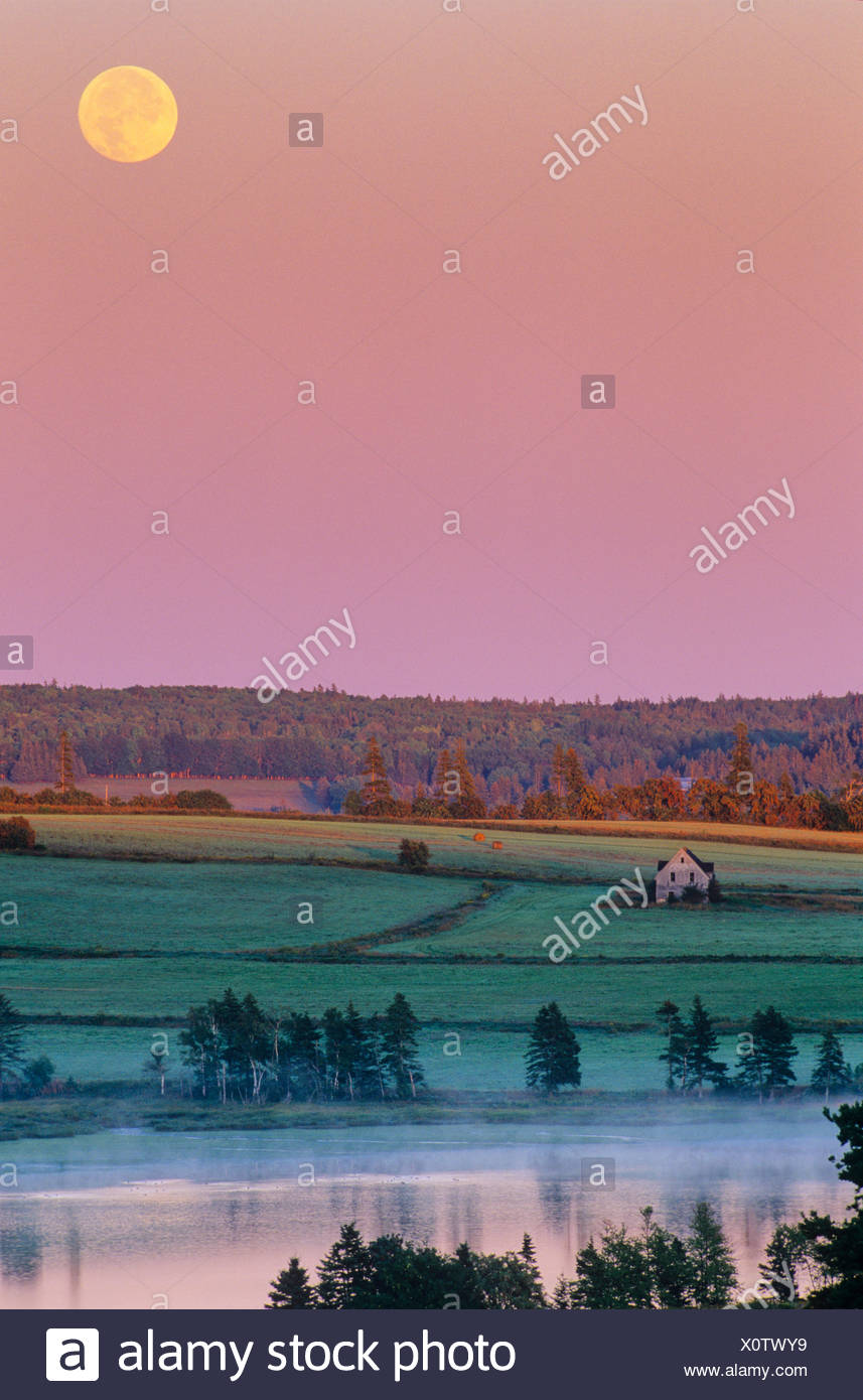 Moon over Clyde River at dawn, Prince Edward Island, Canada - Stock Image