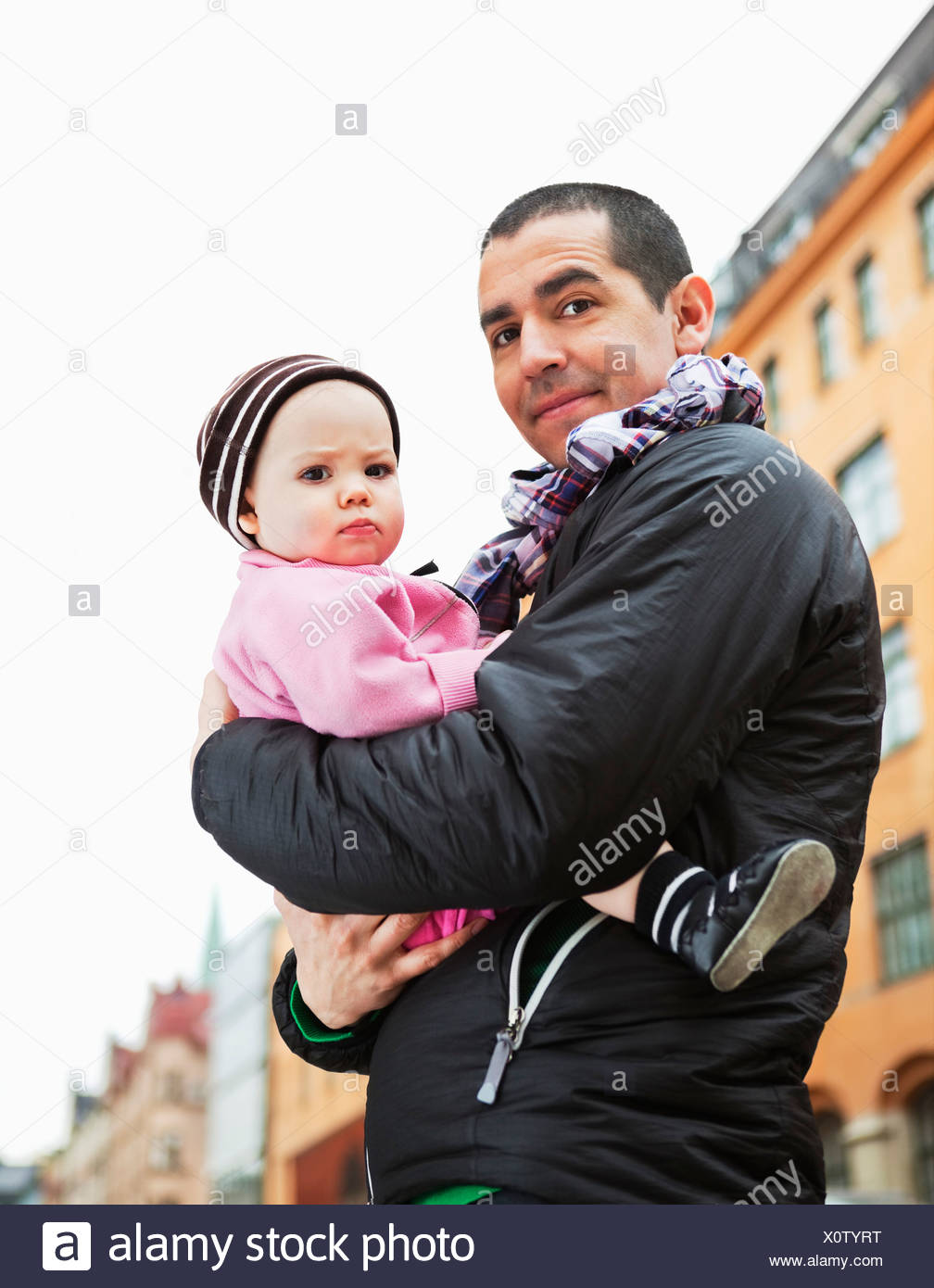 Father holding his daughter (0-11 months) Stock Photo
