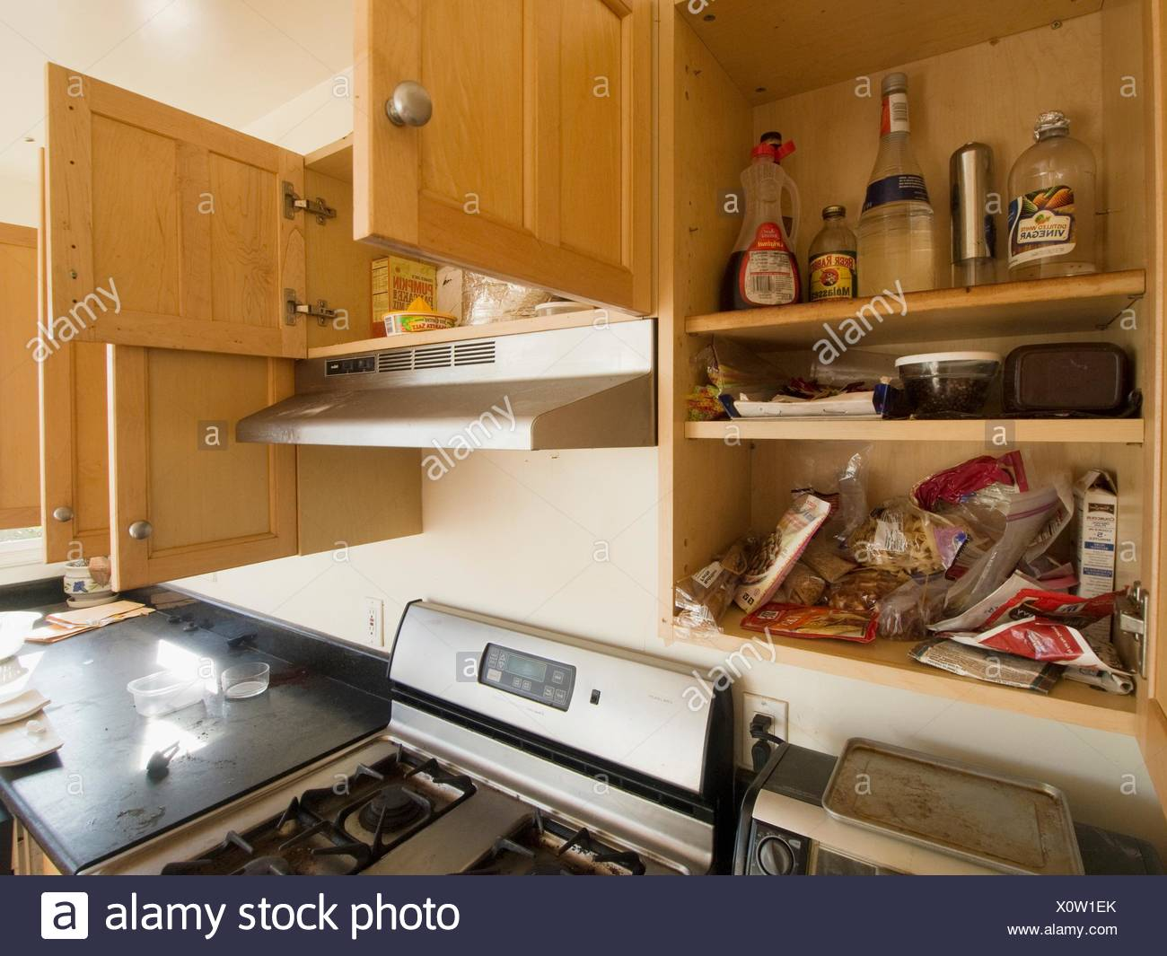 Some packaged foods and products remain in the cabinets of a kitchen inside a foreclosed home in Oakland, California, Uniited Stock Photo
