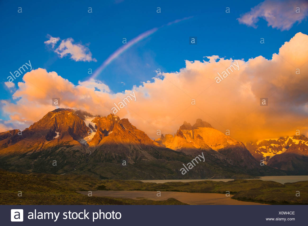 Rainbow and Cuernos del Paine at Sunrise, Torres del Paine National Park, Patagonia, Chile - Stock Image