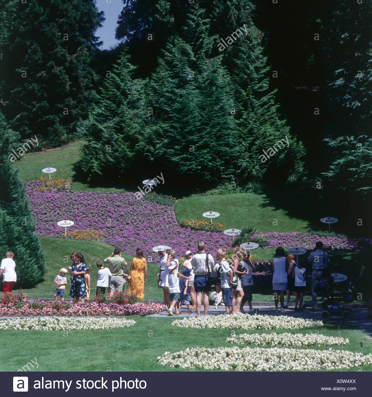 Tourists at formal gardens, Insel Mainau, Baden-Wurttemberg, Germany - Stock Image