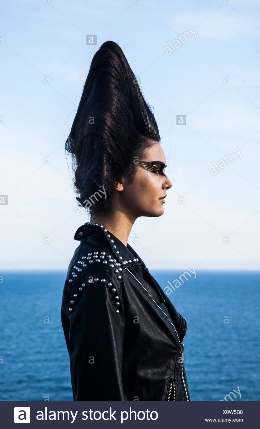 Portrait of a young woman modeling by the sea - Stock Image