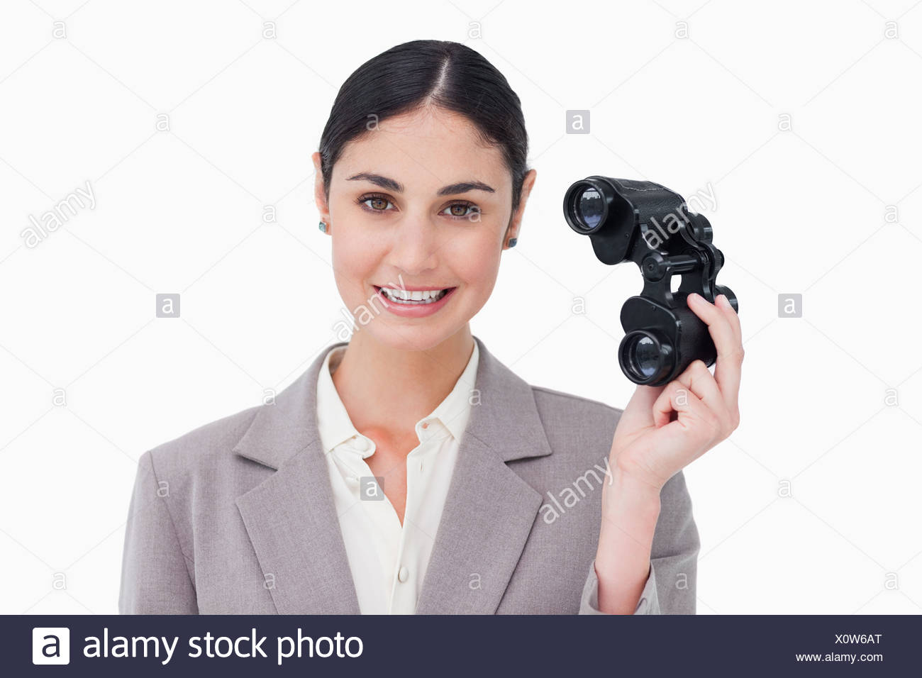 Businesswoman with spy glasses - Stock Image