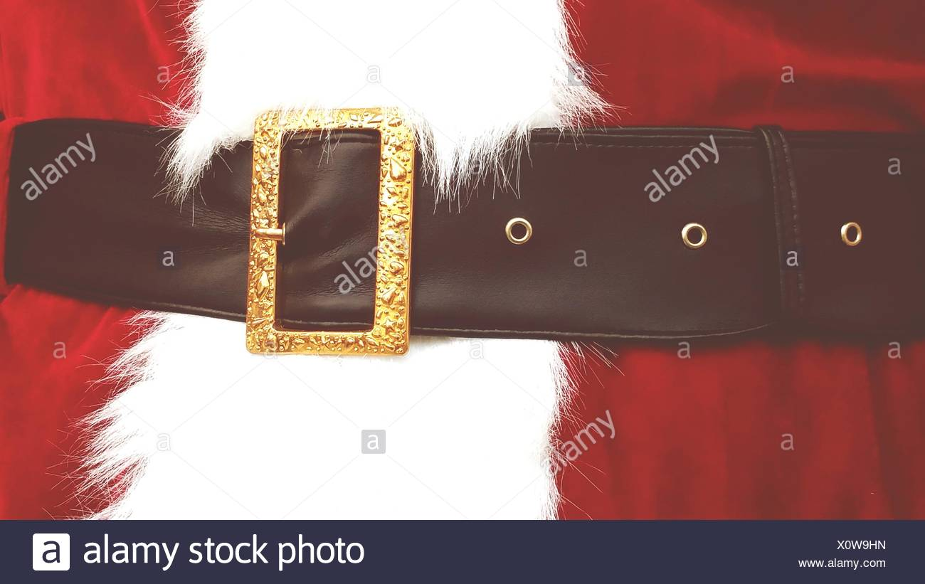 Midsection Of Person In Santa Claus Costume - Stock Image