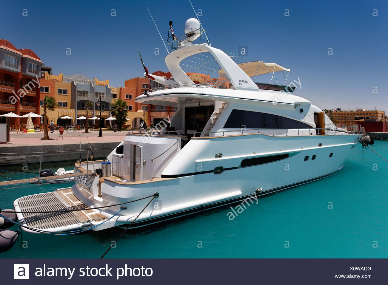 Private yacht in front of houses in the marina, Hurghada, Egypt, Red Sea, Africa - Stock Image