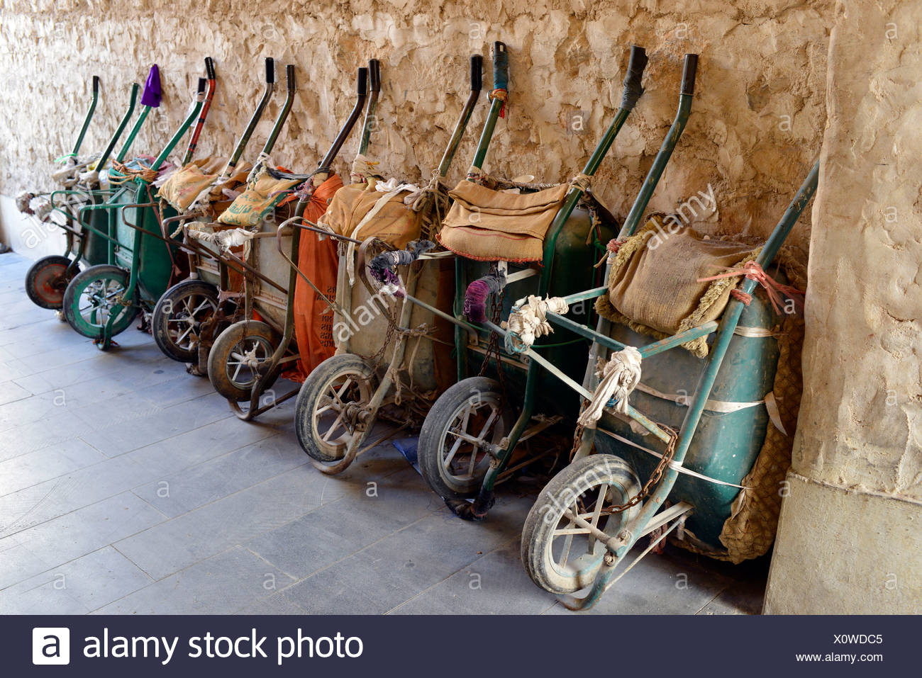 Parking for wheelbarrows, push carts, main means of transport in the Souq al Waqif, oldest souq or bazaar in the country, Doha Stock Photo