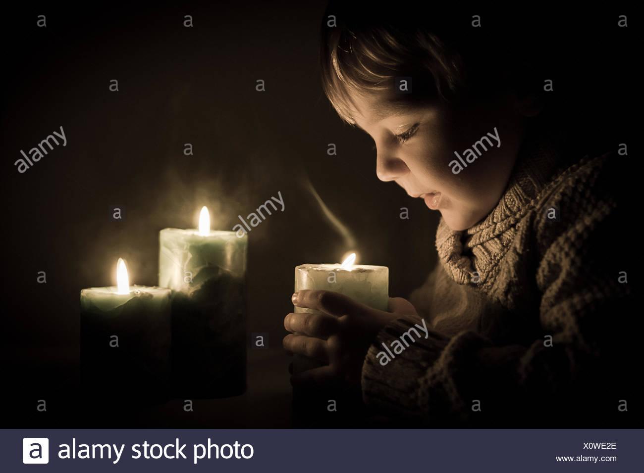 Boy holding candle - Stock Image