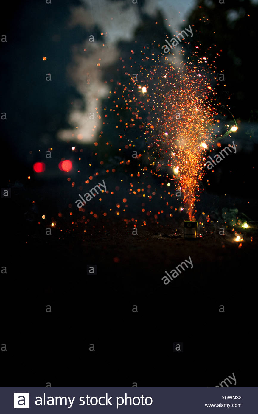 Fireworks exploding at night - Stock Image