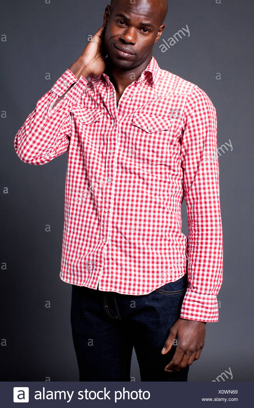 Man wearing plaid shirt - Stock Image