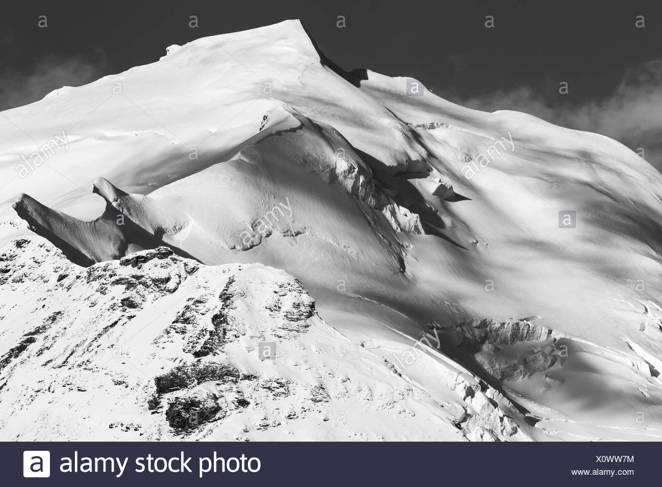 The ice-capped peak of Mount Silvertip rises into the sky in the eastern half of the Alaska Range; Alaska, United States - Stock Image