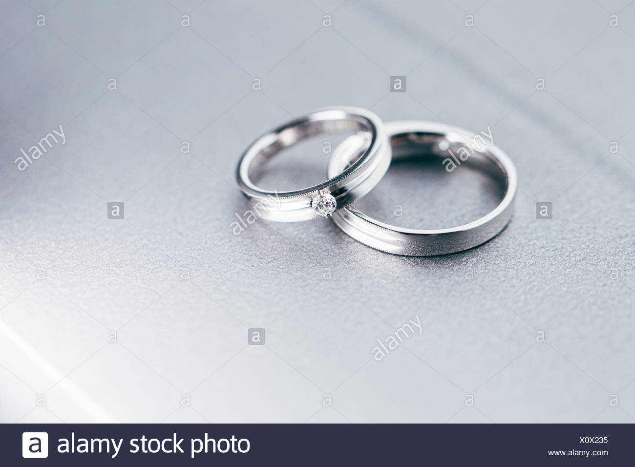 High Angle View Of Platinum Wedding Rings On Table - Stock Image