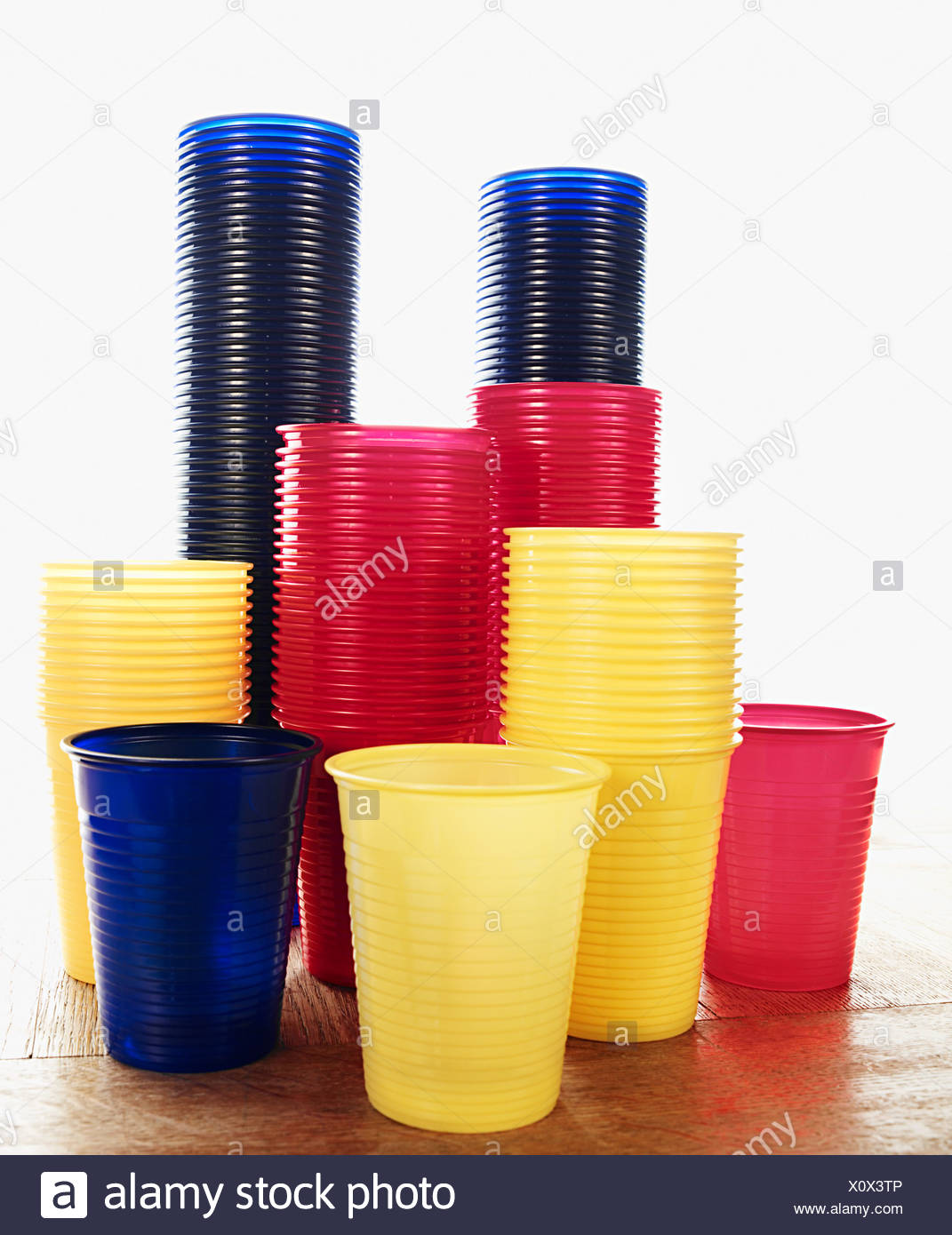 Stacked plastic cups - Stock Image