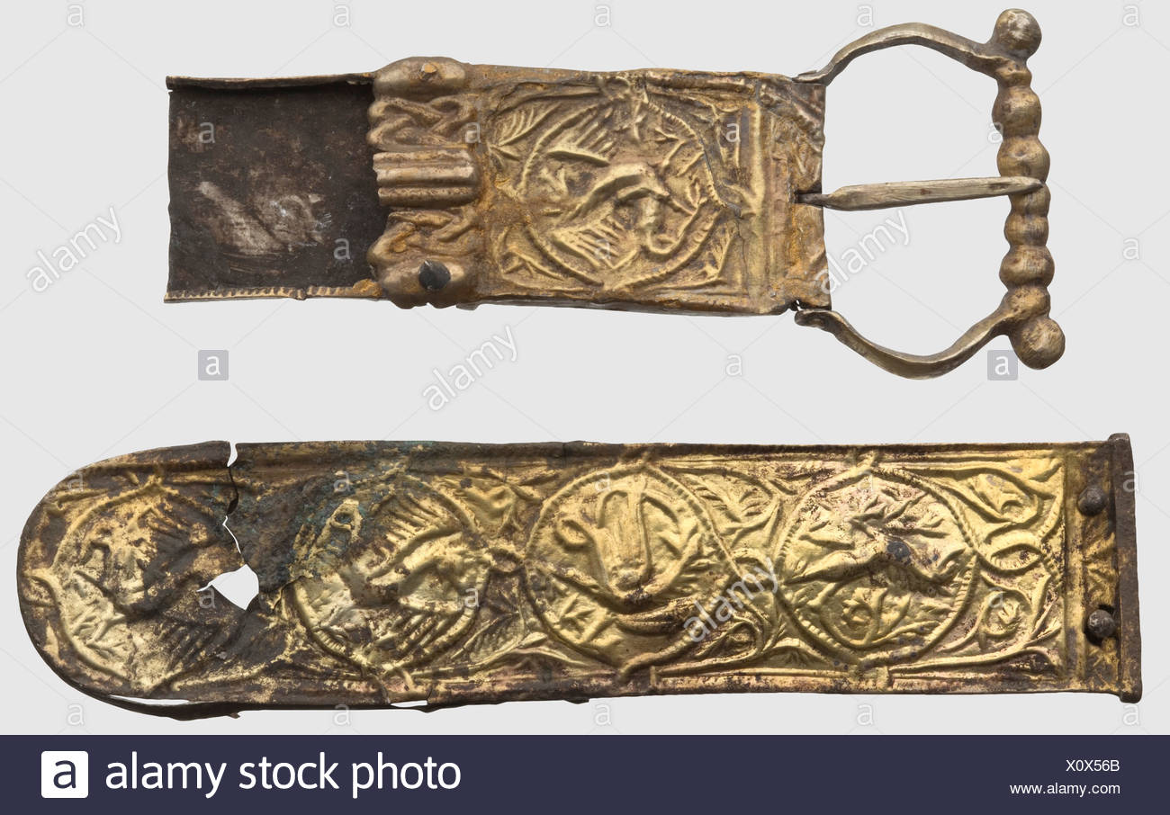 German silver gilt belt fittings, 12th century. Consisting of a buckle, a clasp and 40 fitting parts of circular and oblong shape. The buckle and clasp with intricately embossed griffins and flowers on the obverse, the fittings mostly with preserved silver rivets. A few pieces damaged and incomplete. Length of the clasp 10.1 cm. Provenance: South German private collection, 1970s and later, historic, historical, 20th century, 12th century, ancient world, ancient times, object, objects, stills, clipping, cut out, cut-out, cut-outs, mediterranean, precious metal, , Additional-Rights-Clearences-NA - Stock Image