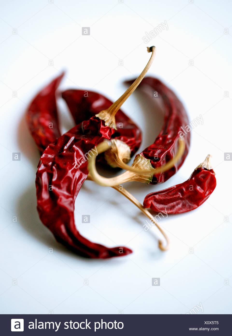 Chili peppers over white background Stock Photo