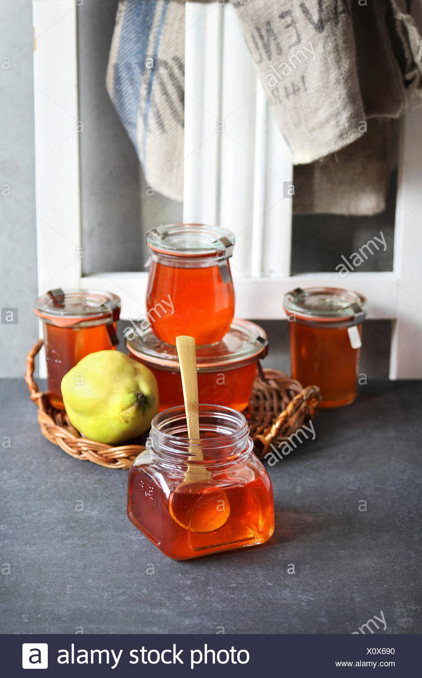 Quince jelly in a jar - Stock Image