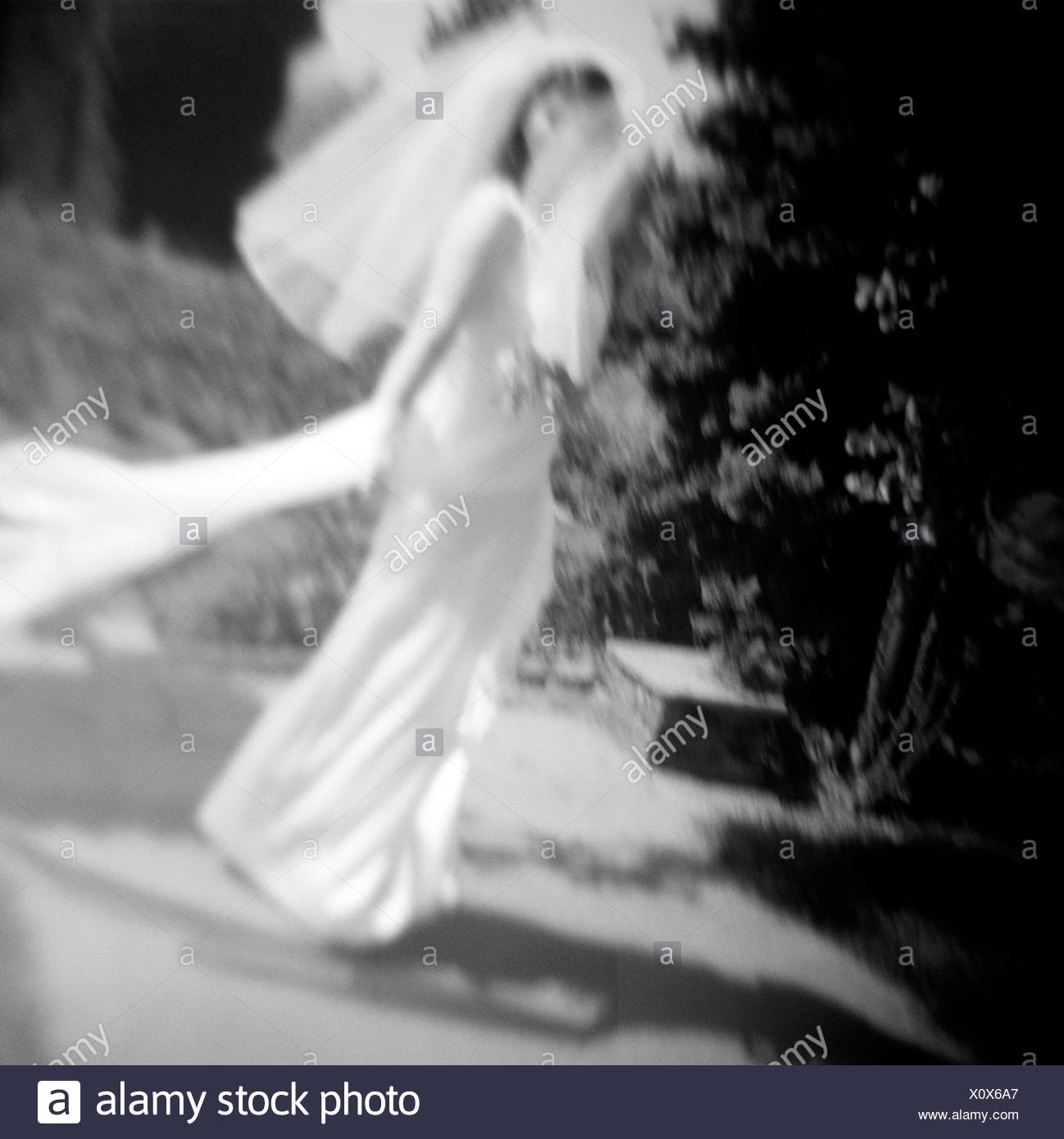 Blurry Bride in Garden - Stock Image