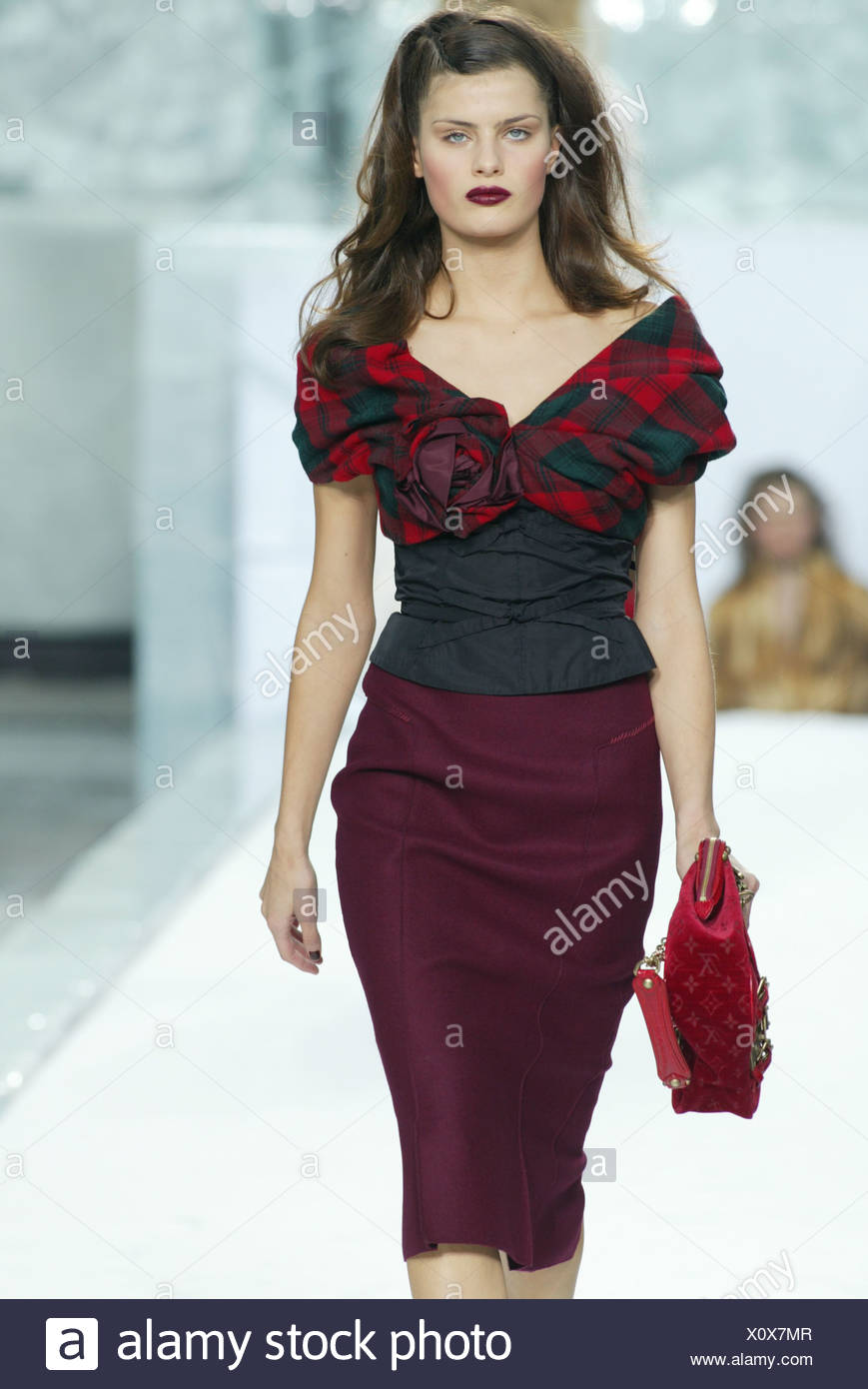 ca5fadbd906a9d Model long brunette hair wearing black off the shoulder top red and green  tartan sleeves and burgundy fabric flower, wearing