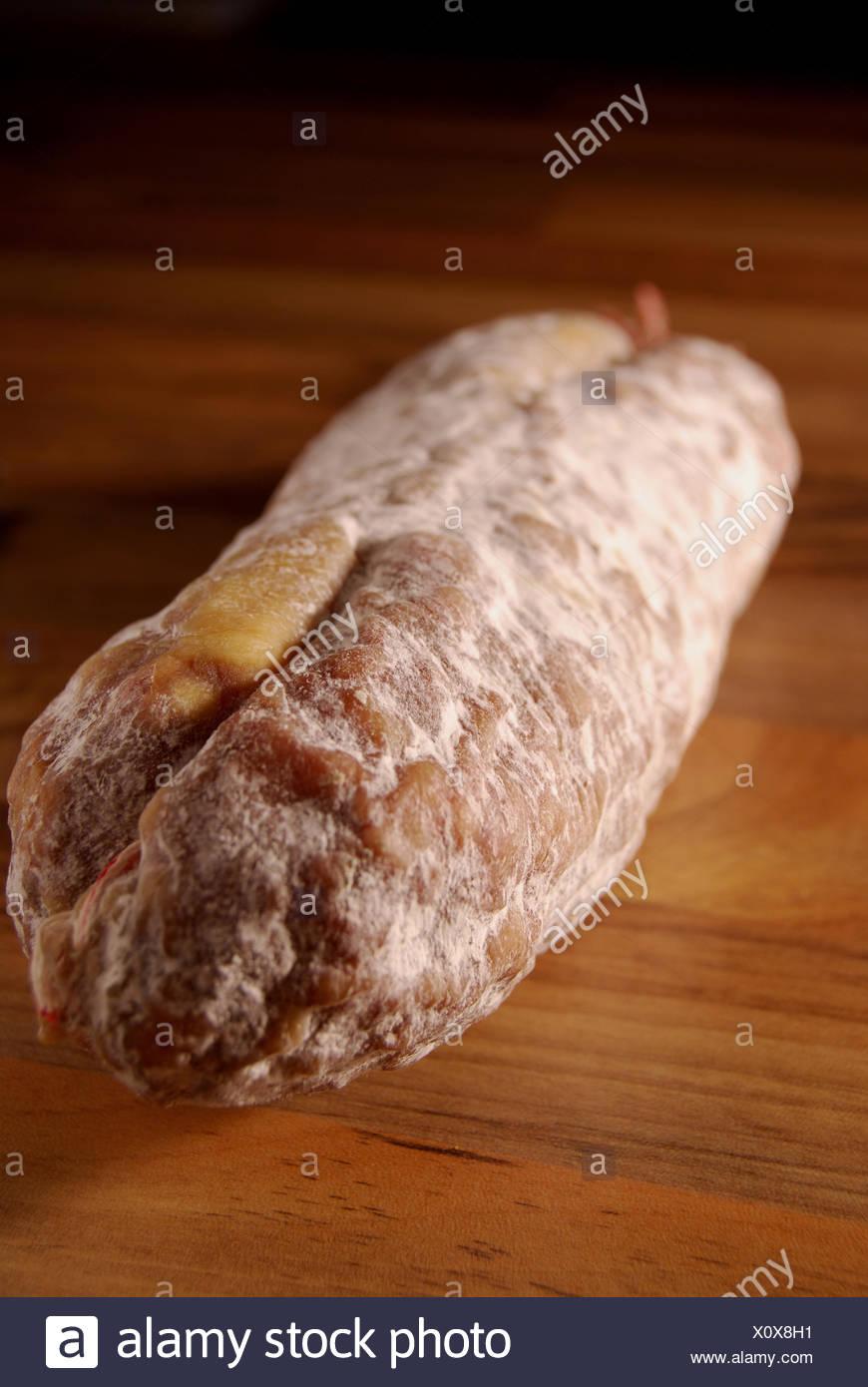 Whole uncut salami - Stock Image